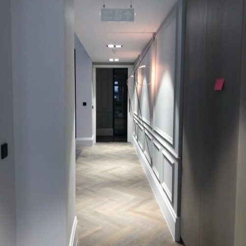fitted electric lights in a hall way